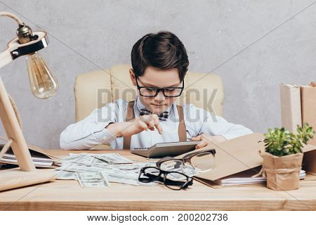 Kid Using Calculator