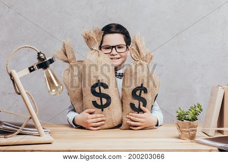 Little Boy With Moneybags