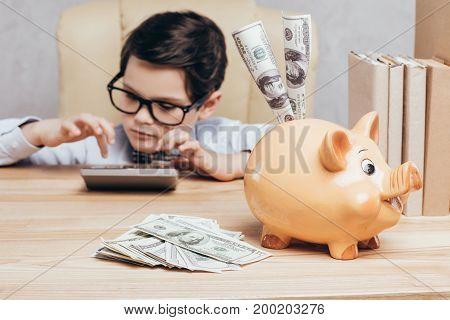 Kid Using Calculator At Workplace