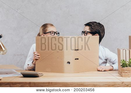 Children With Folder At Workplace