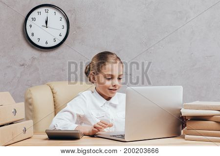 Kid With Laptop At Workplace