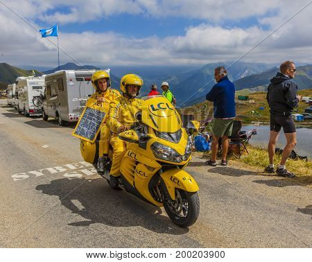 Col de la Croix de Fer France - 25 July 2015:The yellow LCL timekeeper bike passing before the peloton on the road to the Col de la Croix de Fer in Alps during the stage 20 of Le Tour de France 2015.