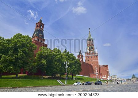 View on Moscow Red Square, Kremlin towers world famous Spasskaya Bashnya with clock touristic symbol of Moscow, Imperial, Nabatnaya. Moscow holidays vacation tours famous sightseeing points..