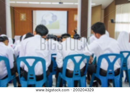 blur of student seminar in the lecture room which has projector screen white with copy space add text