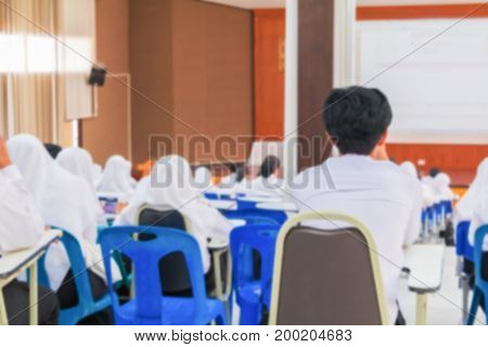 blur education of student  seminar in the lecture room which has projector screen white with copy space add text