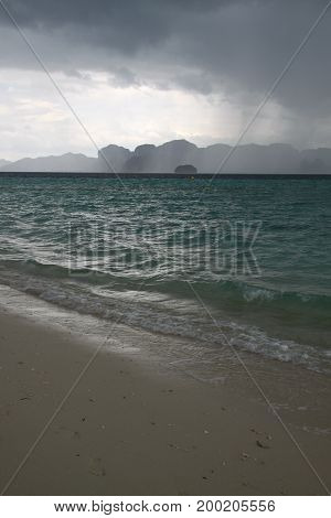 Grey reiny sky and storm on the beach