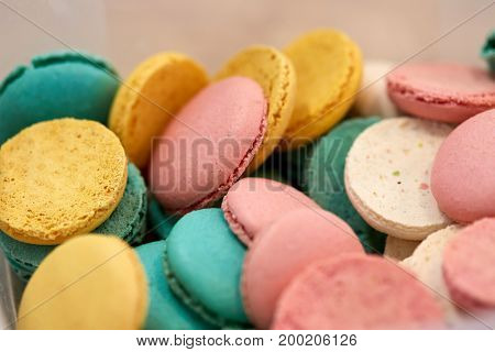 cooking, confectionery and baking concept - close up of macarons