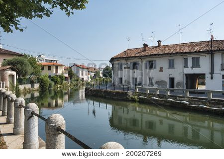 Gorgonzola (Milan Lombardy Italy): the canal of Martesana with historic buildings reflected in the water