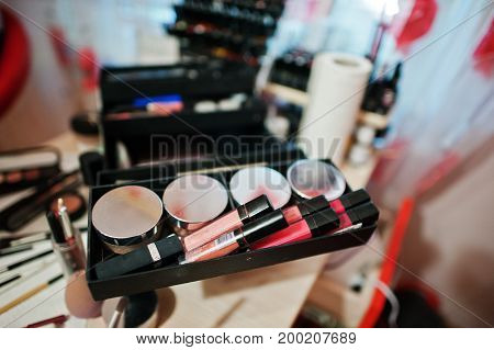 Makeup Brush And Cosmetics Palette At Table.