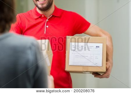 home delivery service, mail, people and shipping concept - happy man delivering parcel box to customer