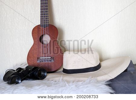 Accessories for lucky travel. guitar, hat, binoculars and bag