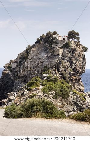 The small church on the hill above the sea( Skopelos island, Greece)