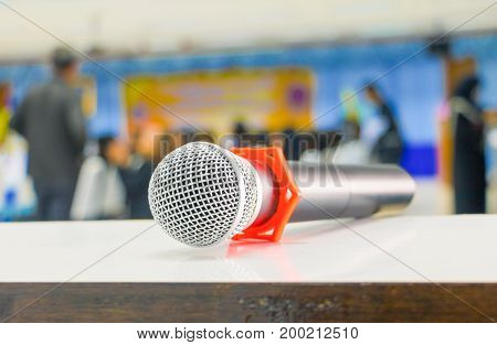 microphone wireless Close up in conference seminar room with copy space add text :Select focus with shallow depth of field.