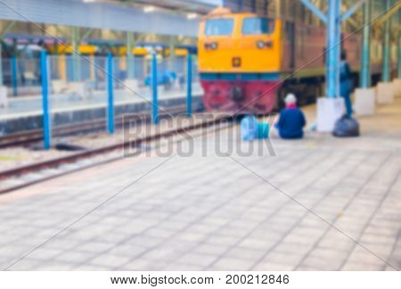 blur people Sitting on the floor At train station with copy space add text