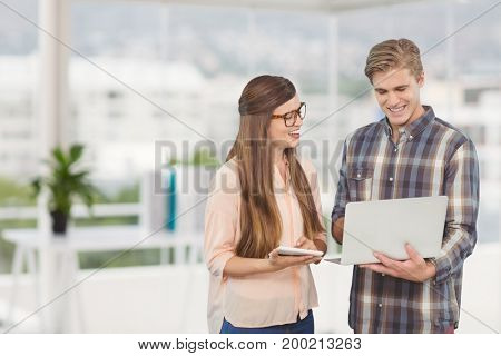 Digital composite of Happy business people looking at a computer