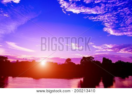 sunset in sky reflex river beautiful colorful landscape silhouette tree woodland twilight time with copy space add text