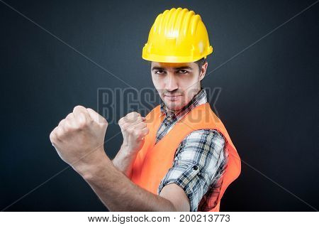 Constructor Wearing Equipment Showing Both Fists Like Fighting