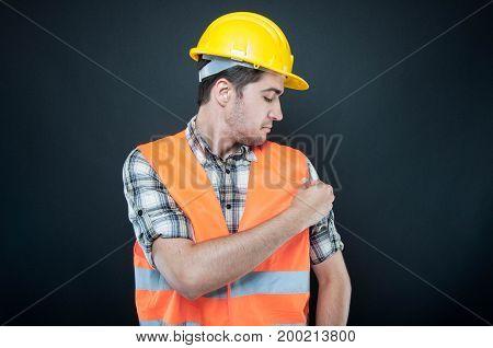 Handsome Constructor Arranging His Reflecting Vest
