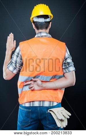 Back View Of Constructor Taking Fake Oath