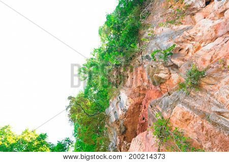 rock cliff mountain in nature beautiful of large caves stone on white background with copy space add text
