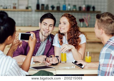 Young Couple With Friends In Cafe