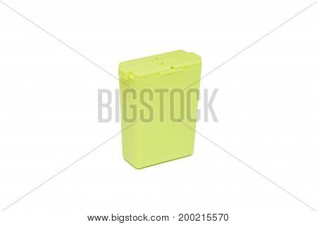 Close up green plastic salt shaker isolated on white background