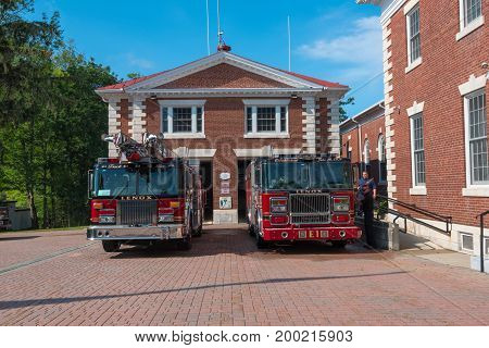 Lenox MA USA 8/17/2017 -- Two fire engines are parked ouside the firehouse in Lenox MA. Editorial Use Only