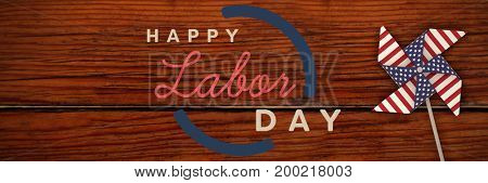 Digital composite image of happy labor day text with blue outline against wood panelling