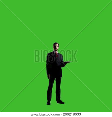 Businessman with computer tablet standing over chroma key background. Business, career job concept.