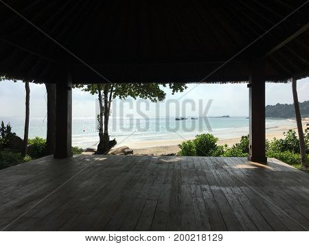 white sand beach view from a yoga Palapa