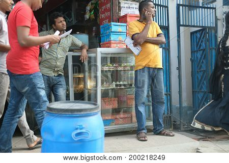 Dhaka, bangladesh, august 2017- group of young university people drinking tea and sharing ideas at local footpath tea store taken at motijhil, dhaka, bangladesh on 17 august 2017.