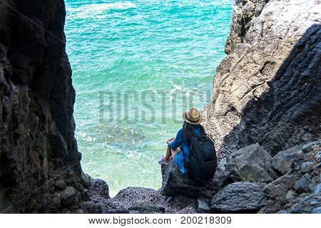 Travel people women tourist in a cave near the sea in Keo Sichang Thailand. Travel Concept