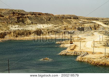 Natural gypsum quarry with the small lakes