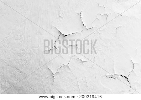 Cracked flaking paint on wall background texture
