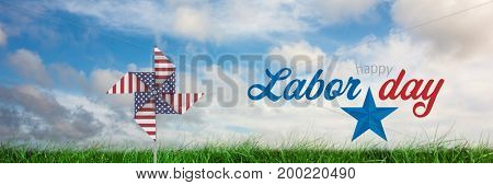 Digital composite of Happy labor day text and USA wind catcher in front of grass and sky