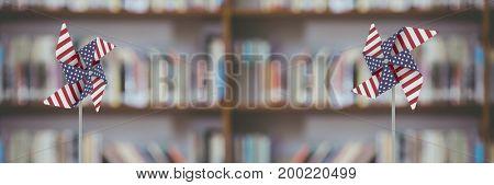 Digital composite of USA wind catchers in front of bookshelf