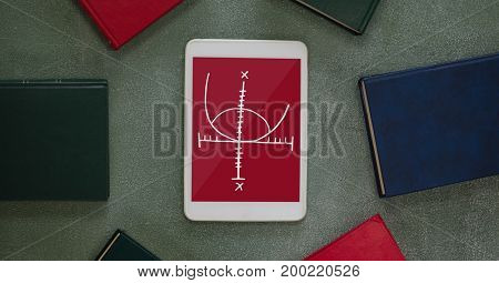 Digital composite of Tablet with school icons on screen