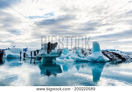 Floating icebergs in the glacial lake Jokulsarlon in Iceland.