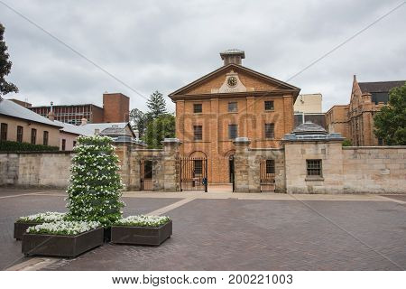 SYDNEY,NSW,AUSTRALIA-NOVEMBER 19,2016: Hyde Park Barracks Museum historic compound on a cloudy day in Sydney, Australia.