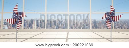 Digital composite of USA wind catchers in front of windows over city