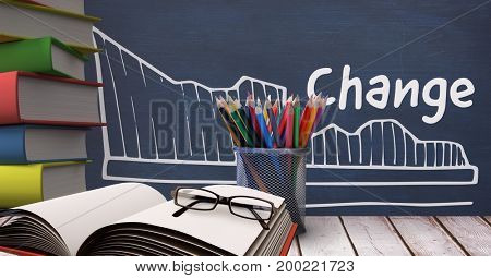 Digital composite of Books on the table against blue blackboard with education and school graphics