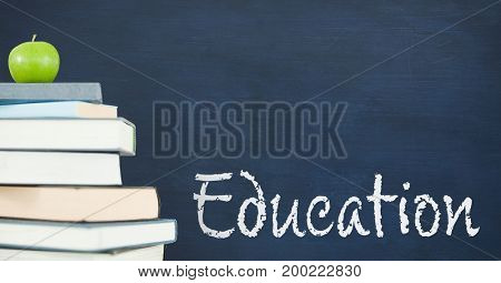 Digital composite of Books on the table against blue blackboard with education text