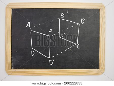 Digital composite of geometry cube measurement diagram on blackboard