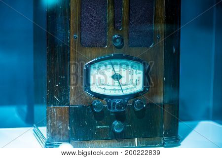 antique vintage radio on modern blue background