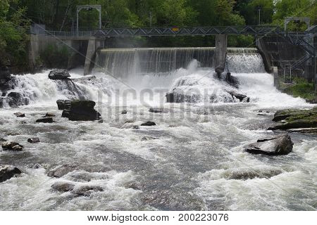 hydroelectric dam on river waterfalls power plant