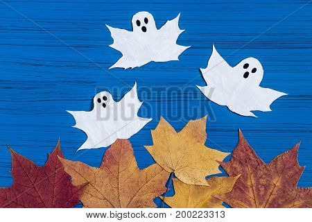 Making ghosts from maple leaves to Halloween. Halloween decor of room. Children's art project. DIY concept. Step-by-step photo instructions. Step 5. Final result