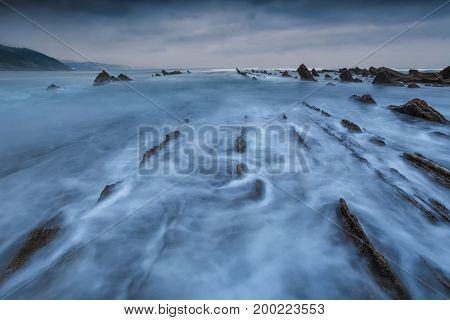 Waves in Sakoneta beach geopark in Deba