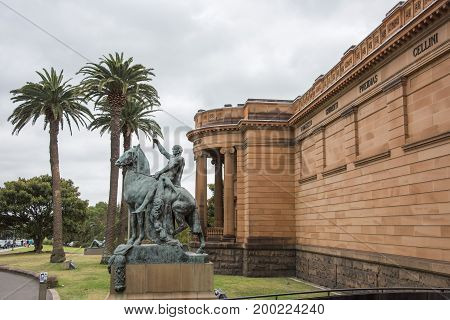 SYDNEY,NSW,AUSTRALIA-NOVEMBER 29,2016: Exterior of the Art Gallery of New South Wales with sculpture, palm trees and tourists in Sydney, Australia