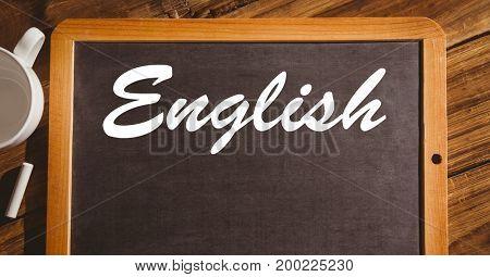 Digital composite of English text on blackboard