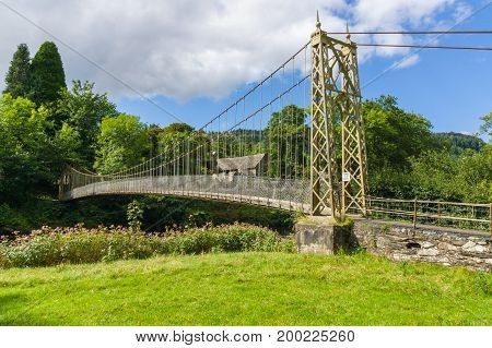 The Sappers suspension bridge over the River Conwy built in 1930 and a prominent landmark in the village of Betws-y-Coed in North Wales